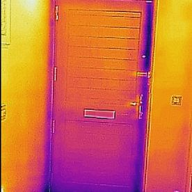 Warped Front Door Showing Heat Loss
